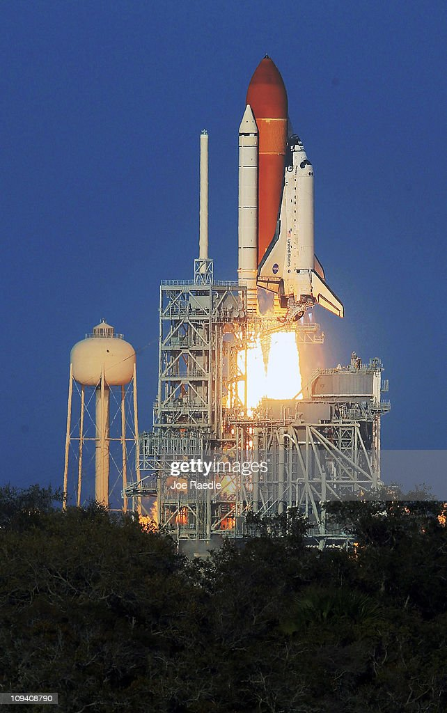 Space shuttle Discovery lifts off from launch pad 39A at the Kennedy Space Center on February 24, 2011 in Cape Canaveral, Florida. As the Shuttle Program winds down, Space Shuttle Discovery is on its 39th and final mission to the International Space Station.