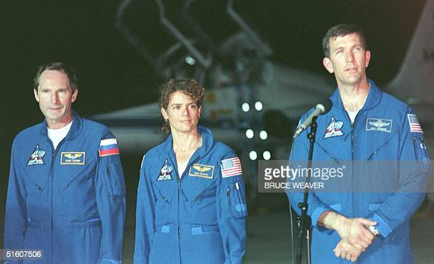 US space shuttle Discovery Pilot Rick Husband of the US addresses the media 23 May 1999 as crew members Astronaut Julie Payette of Canada and...