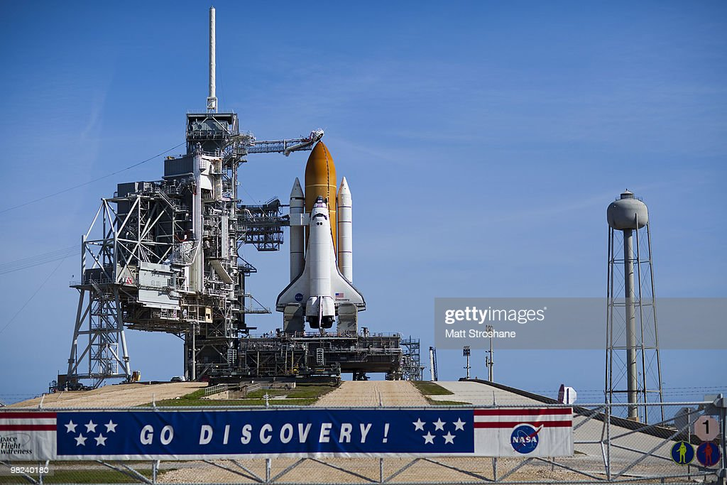 Space Shuttle Discovery sits on launch pad 39-A as the rotating service structure rolls back at Kennedy Space Center on April 4, 2010, in Cape Canaveral. Discovery is being prepared for a April 5th launch for a mission to the International Space Station.