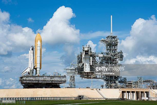 Space Shuttle Discovery sitting atop the crawler transporter rolls out to launch pad 39A at the Kennedy Space Center August 4 2009 in Cape Canaveral...