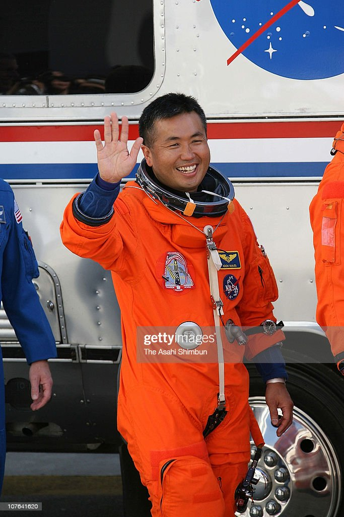 Space Shuttle Discovery STS-119 mission specialist <a gi-track='captionPersonalityLinkClicked' href=/galleries/search?phrase=Koichi+Wakata&family=editorial&specificpeople=220363 ng-click='$event.stopPropagation()'>Koichi Wakata</a> boards an Airstream motorhome to be transported to launch pad 39-A after walking out of the Operations and Checkout Building at the Kennedy Space Center on March 15, 2009 in Cape Canaveral, Florida.