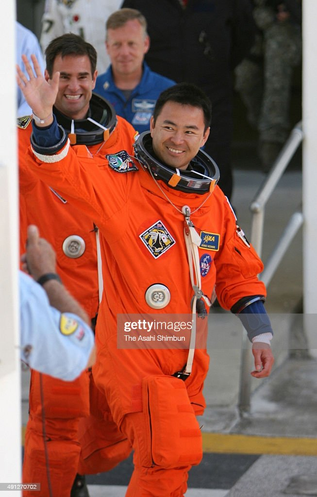 Space Shuttle Discovery STS-124 mission specialist <a gi-track='captionPersonalityLinkClicked' href=/galleries/search?phrase=Akihiko+Hoshide&family=editorial&specificpeople=5329772 ng-click='$event.stopPropagation()'>Akihiko Hoshide</a> of the Japanese Space Agency JAXA, walks out of the operations and checkout building on his way to the launch pad at Kennedy Space Center May 31, 2008, in Cape Canaveral, Florida. Discovery is scheduled to lift off for the International Space Station May 31.