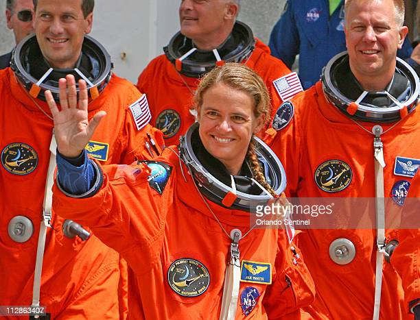 Space shuttle Endeavour astronaut Julie Payette center waves Monday July 13 to supporters as the crew of 7 astronauts leave the crew quarters to...