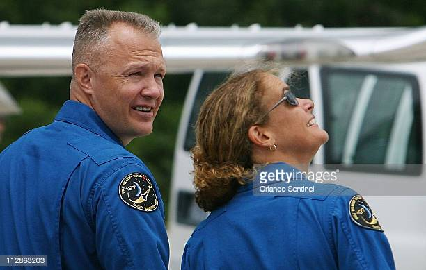 Space shuttle Endeavour astronauts pilot Douglas Hurley left and mission specialist Julie Payette of the Canadian Space Agency look to rain filled...
