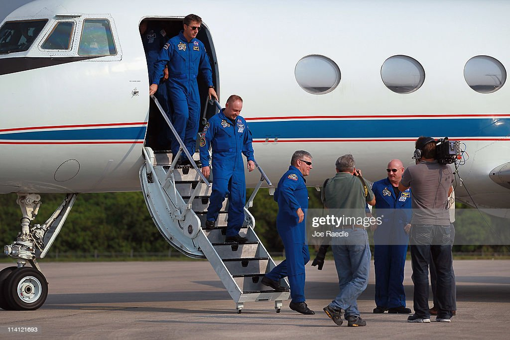 Space shuttle Endeavour commander Mark Kelly (R), along with crew members Roberto Vittori, Michael Fincke and pilot Gregory Johnson, walk off a plane as they arrive at Kennedy Space Center on May 12, 2011 in Cape Canaveral, Florida. Commander Kelly's wife, congresswoman Gabrielle Giffords, who was shot in the head at a meet-and-greet in her hometown of Tucson, Arizona, plans on attending the launch. Space shuttle Endeavour is scheduled to launch on its final flight to the space station on May 16th.