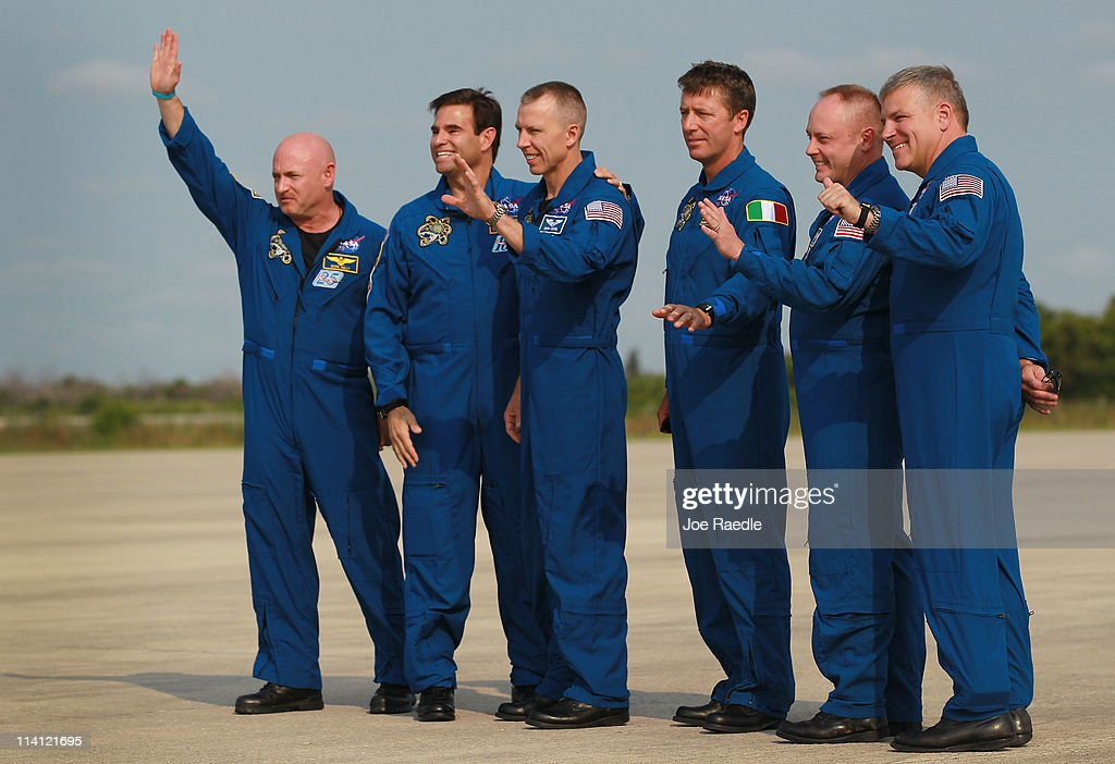 Space shuttle Endeavour commander <a gi-track='captionPersonalityLinkClicked' href=/galleries/search?phrase=Mark+Kelly&family=editorial&specificpeople=566699 ng-click='$event.stopPropagation()'>Mark Kelly</a> (L-R) along with crew members Greg Chamitoff, Andrew Feustel, Roberto Vittori, Michael Fincke and pilot Gregory Johnson pose for a photograph after their arrival at Kennedy Space Center on May 12, 2011 in Cape Canaveral, Florida. Commander Kelly's wife, congresswoman Gabrielle Giffords, who was shot in the head at a meet-and-greet in her hometown of Tucson, Arizona, plans on attending the launch. Space shuttle Endeavour is scheduled to launch on its final flight to the space station on May 16th.