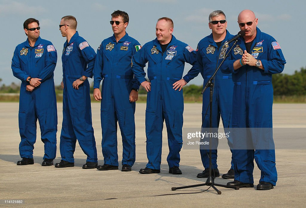 Space shuttle Endeavour commander Mark Kelly (R) speaks to the media as crew members Greg Chamitoff, Andrew Feustel, Roberto Vittori, Michael Fincke and pilot Gregory Johnson stand beside him after their arrival at Kennedy Space Center on May 12, 2011 in Cape Canaveral, Florida. Commander Kelly's wife, congresswoman Gabrielle Giffords, who was shot in the head at a meet-and-greet in her hometown of Tucson, Arizona, plans on attending the launch. Space shuttle Endeavour is scheduled to launch on its final flight to the space station on May 16th.