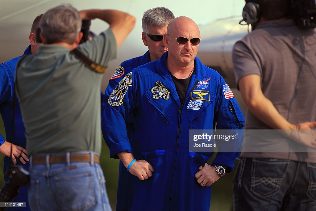 Space shuttle Endeavour crew Commander <a gi-track='captionPersonalityLinkClicked' href=/galleries/search?phrase=Mark+Kelly&family=editorial&specificpeople=566699 ng-click='$event.stopPropagation()'>Mark Kelly</a> as he arrives at Kennedy Space Center on May 12, 2011 in Cape Canaveral, Florida. Commander Kelly's wife, congresswoman Gabrielle Giffords, who was shot in the head at a meet-and-greet in her hometown of Tucson, Arizona, plans on attending the launch. Space shuttle Endeavour is scheduled to launch on its final flight to the space station on May 16th.
