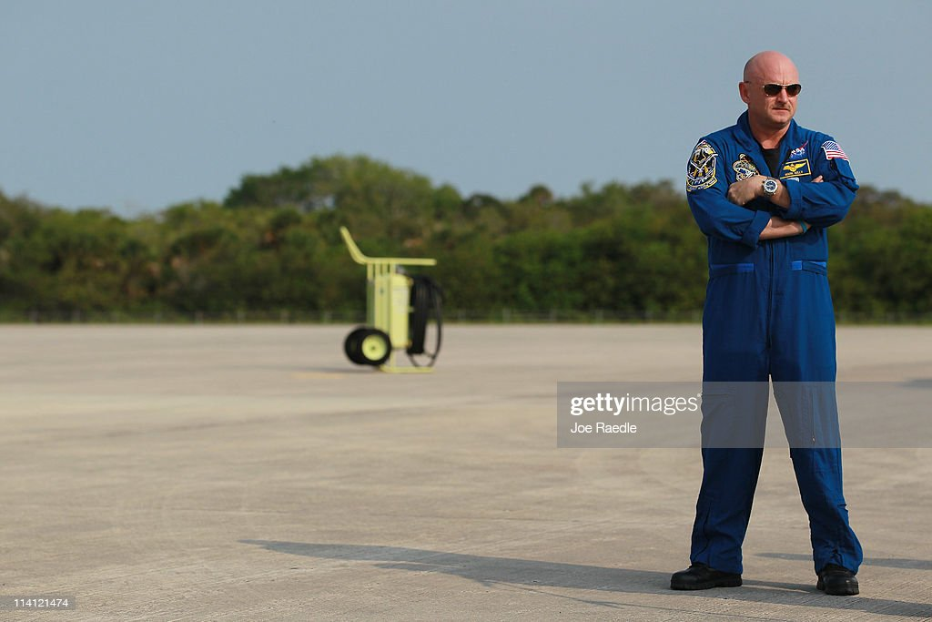 Space shuttle Endeavour crew Commander <a gi-track='captionPersonalityLinkClicked' href=/galleries/search?phrase=Mark+Kelly&family=editorial&specificpeople=566699 ng-click='$event.stopPropagation()'>Mark Kelly</a> stands on the tarmac after he arrived at Kennedy Space Center on May 12, 2011 in Cape Canaveral, Florida. Commander Kelly's wife, congresswoman Gabrielle Giffords, who was shot in the head at a meet-and-greet in her hometown of Tucson, Arizona, plans on attending the launch. Space shuttle Endeavour is scheduled to launch on its final flight to the space station on May 16th.