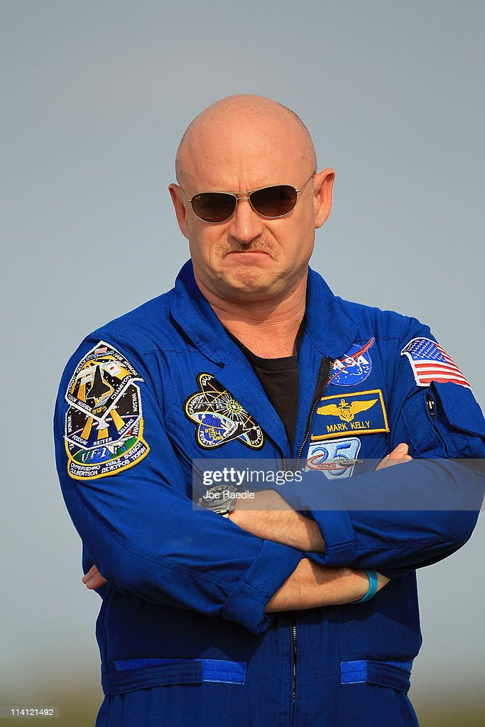 Space shuttle Endeavour crew Commander <a gi-track='captionPersonalityLinkClicked' href=/galleries/search?phrase=Mark+Kelly+-+Astronauta+e+ufficiale&family=editorial&specificpeople=566699 ng-click='$event.stopPropagation()'>Mark Kelly</a> stands on the tarmac after he arrived at Kennedy Space Center on May 12, 2011 in Cape Canaveral, Florida. Commander Kelly's wife congresswoman Gabrielle Giffords, who was shot in the head at a meet-and-greet in her hometown of Tucson, Arizona, plans on attending the launch. Space shuttle Endeavour is scheduled to launch on its final flight to the space station on May 16th.