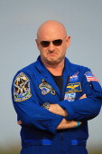 Space shuttle Endeavour crew Commander Mark Kelly stands on the tarmac after he arrived at Kennedy Space Center on May 12 2011 in Cape Canaveral...