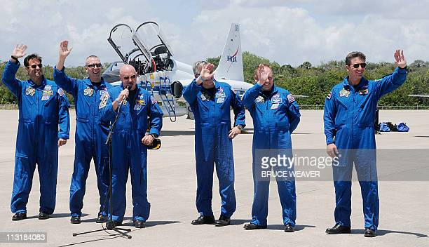 Space shuttle Endeavour crew Greg Chamitoff Andrew Feustel Commander Mark Kelly Pilot Gregory Johnson Michael Fincke and Roberto Vittori of Italy as...