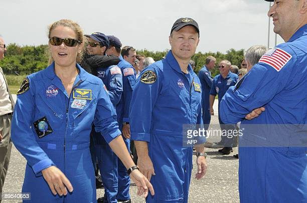 Space shuttle Endeavour crewmembers Canadian Space Agency astronaut Julie Payette pilot Doug Hurley and commander Mark Polansky after landing July 31...