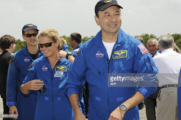 Space shuttle Endeavour crewmembers Tom Marshburn Canadian Space Agency astronaut Julie Payette and commander Mark Polansky after landing July 31...