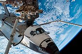 August 15, 2007 - Backdropped by a blue and white Earth and the blackness of space, Space Shuttle Endeavour, docked to the Destiny laboratory of the International Space Station, is featured in this im