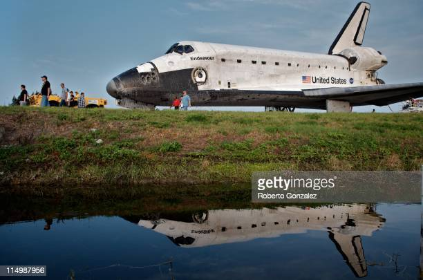 Space Shuttle Endeavour is escorted back to a storage building following it's last mission before being retired at Kennedy Space Center on June 01 in...