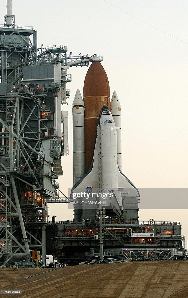 US space shuttle Endeavour is moved early on February 18, 2008 to launch pad 39-A at Kennedy Space Center, Florida. The shuttle and her seven-person crew are scheduled to launch from Kennedy Space Center, Florida on March 11 with the Japanese Logistics Experiment module for the International Space Station (ISS). AFP PHOTO/Bruce WEAVER