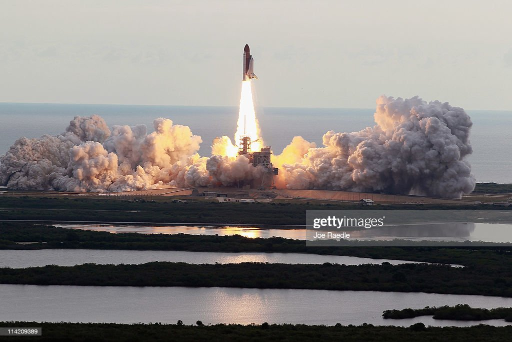 NASA space shuttle Endeavour lifts off from Launch Pad 39A at the Kennedy Space Center on May 16, 2011 in Cape Canaveral, Florida. After 20 years, 25 missions and more than 115 million miles in space, Endeavour is on its final flight to the International Space Station before being retired and donated to the California Science Center in Los Angeles. Capt. Mark E. Kelly, Gabrielle Giffords's husband, will lead mission STS-134 as it delivers the Express Logistics Carrier-3 (ELC-3) and the Alpha Magnetic Spectrometer (AMS-2) to the International Space Station.
