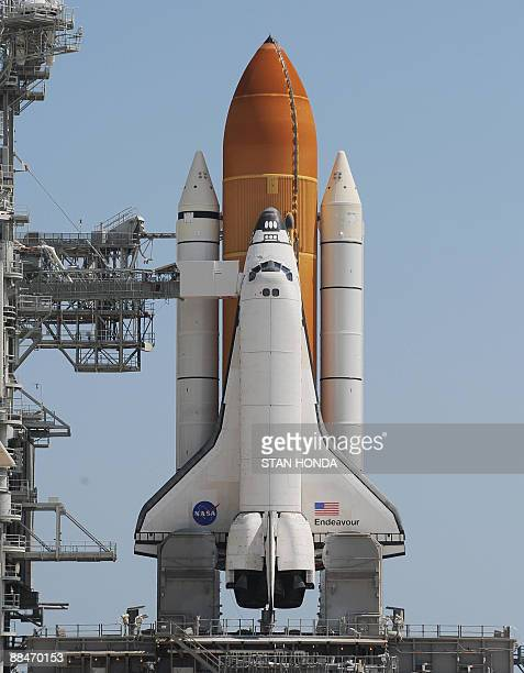 US space shuttle Endeavour sits on the launch pad after the launch was delayed due to a leak in the hydrogen vent line during fueling of the orange...