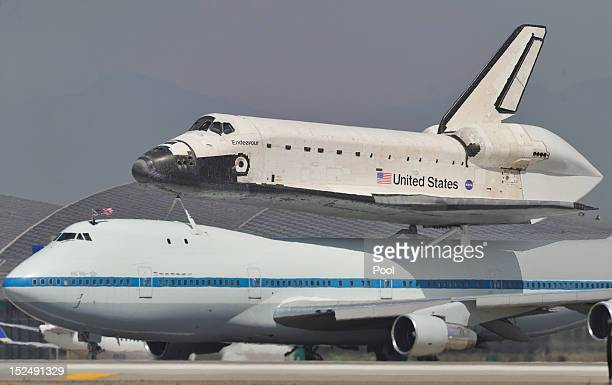 Space shuttle Endeavour sitting on top of NASA's Shuttle Carrier Aircraft or SCA lands at Los Angeles International Airport on September 21 2012 in...