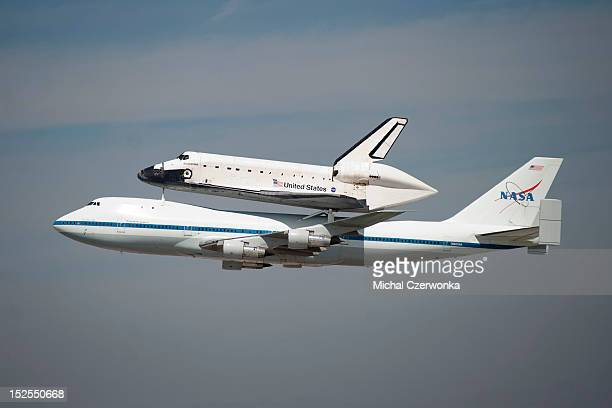 Space shuttle Endeavour sitting on top of NASA's Shuttle Carrier Aircraft or SCA flies over the Los Angeles International Airport on September 21...