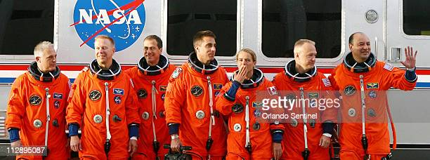 Space shuttle Endeavour STS127 astronaut Julie Payette Canadian Space Agency third from right blows a kiss Thursday June 4 as David Wolf from far...