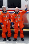 Space Shuttle Endeavour STS134 Commander Mark Kelly and Pilot Greg H Johnson walk out of the Operations and Checkout Building at the Kennedy Space...