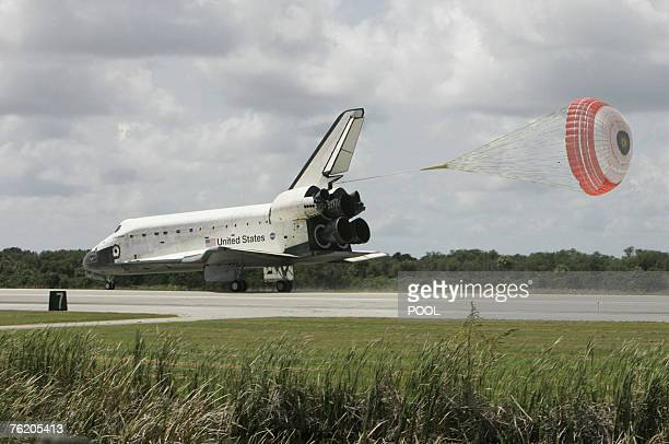 during a space shuttle landing a parachute deploys - photo #8