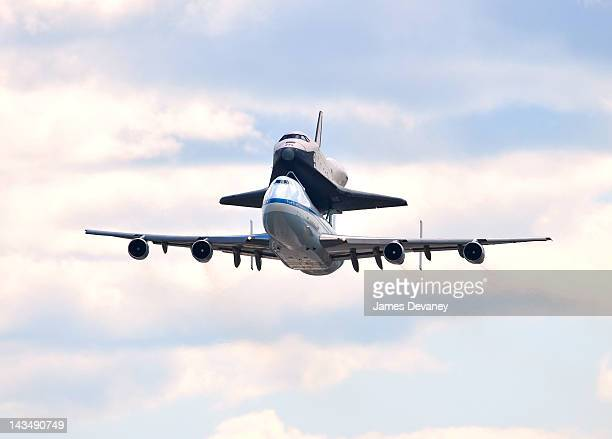 Space Shuttle Enterprise and 747 Shuttle Carrier Aircraft fly over JFK Airport on April 27 2012 in New York City