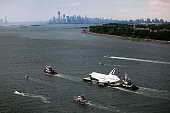 Space Shuttle Enterprise is carried by barge into New York Harbor on June 03 2012 in New York City Enterprise is on it's way to the Intrepid Sea Air...