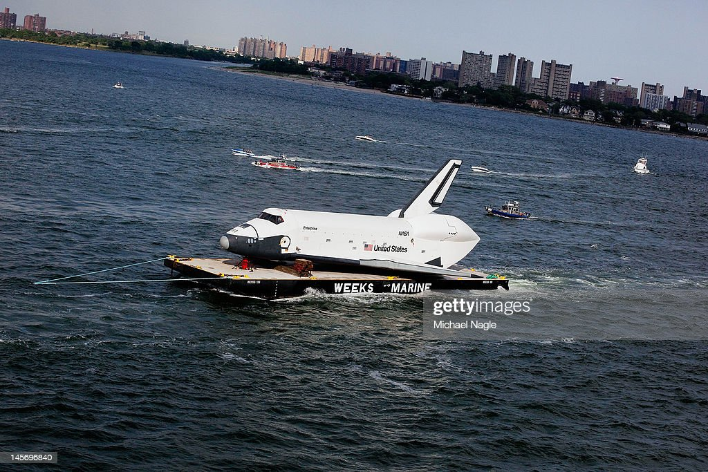 Space Shuttle Enterprise is carried by barge past Coney Island on June 03, 2012 in New York City. Enterprise is on it's way to the Intrepid Sea, Air and Space Museum, where it will put on permanent display.