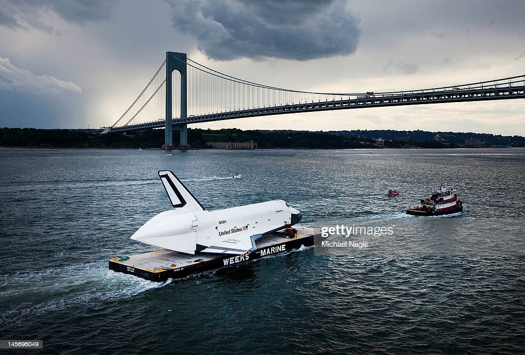 Space Shuttle Enterprise is carried by barge underneath the Verrazano-Narrows Bridge on June 3, 2012 in New York City. Enterprise is on it's way to the Intrepid Sea, Air and Space Museum, where it will put on permanent display.
