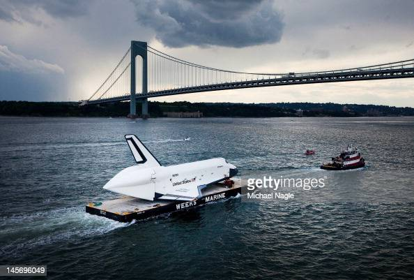 Space Shuttle Enterprise is carried by barge underneath the VerrazanoNarrows Bridge on June 3 2012 in New York City Enterprise is on it's way to the...