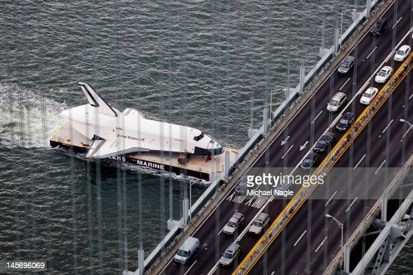 Space Shuttle Enterprise is carried by barge underneath the VerrazanoNarrows Bridge on June 03 2012 in New York City Enterprise is on it's way to the...