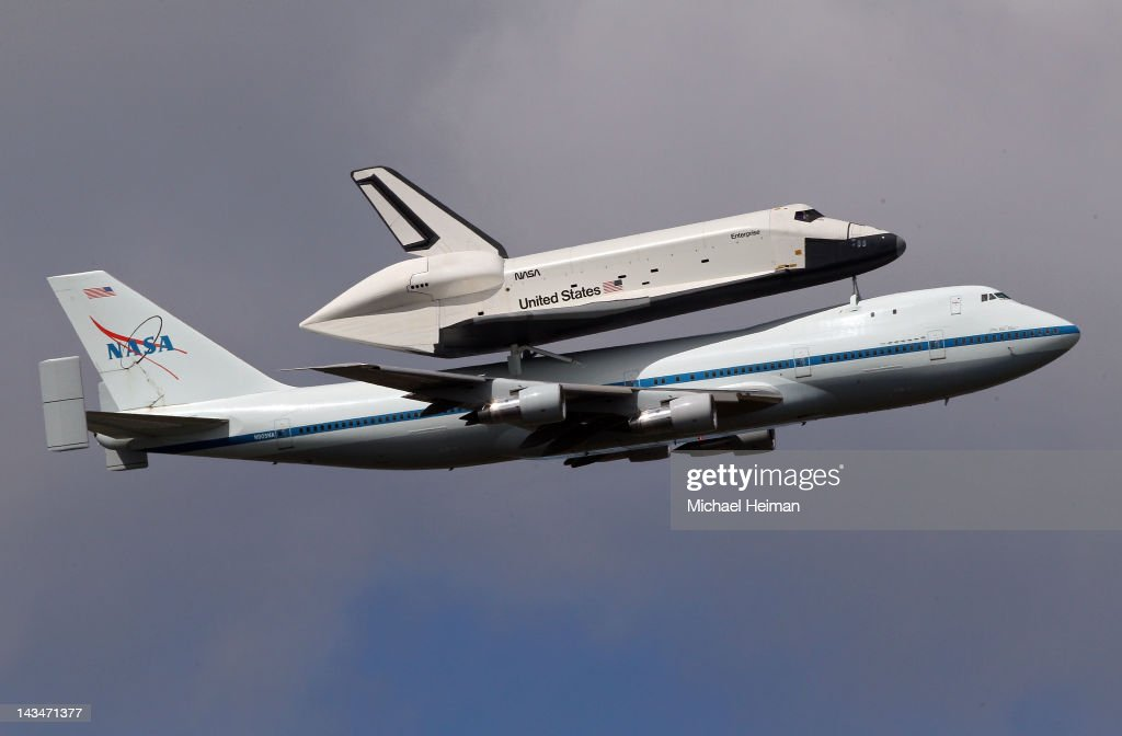 Space shuttle Enterprise, mounted atop a 747 shuttle carrier aircraft, flies past Jersey City prior to landing at John F. Kennedy International Airport on April 27, 2012 in New York City. Enterprise, which was flown from Washington, DC, will eventually be put on permanent display at the Intrepid Sea, Air and Space Museum.