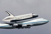 Space Shuttle Enterprise mounted atop a 747 shuttle carrier aircraft flies by prior to landing at John F Kennedy International Airport on April 27...