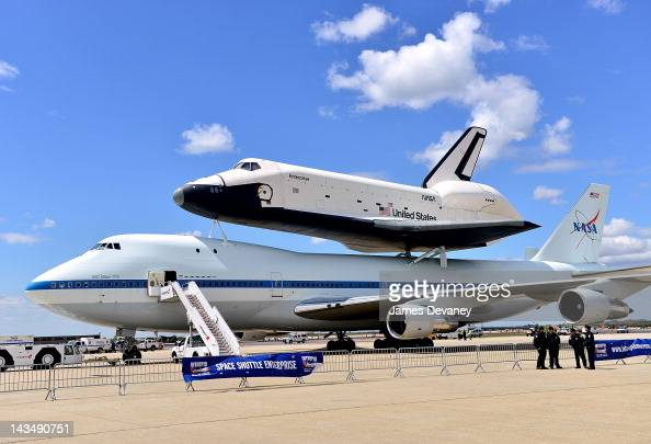 Space Shuttle Enterprise mounted atop of 747 Shuttle Carrier Aircraft at JFK Airport on April 27 2012 in New York City