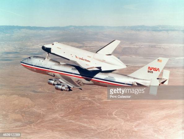 Space Shuttle Orbiter mounted on top of a Boeing 747 carrier aircraft 1977 The Shuttle Orbiter is often transported this way from landing site to...