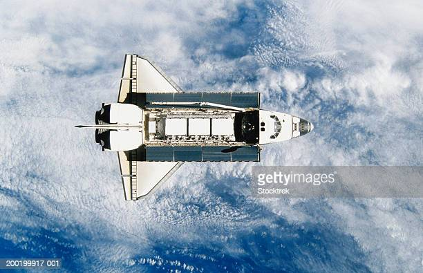 Space shuttle orbiting earth, satellite view