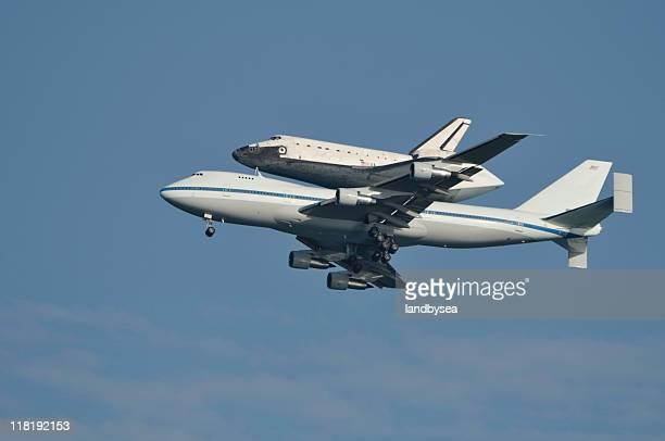 Space Shuttle piggy backed on 747 jet in flight