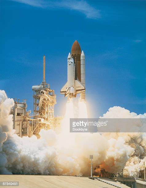 space shuttle taking off from a launch pad