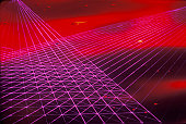 Space special effects composite of converging grids of magenta laser light against a red nebulous sky