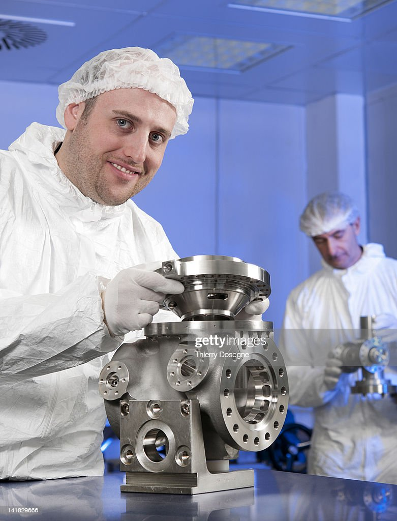 Space technician working in aerospace industry ( w : Stock Photo