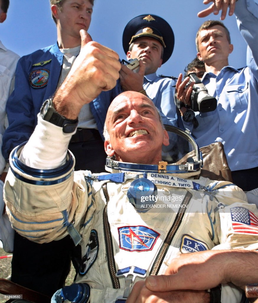 US space tourist Deni Tito gives a thumb up after his landing near the Kazakh town of Arkalyk (some 300 km from Astana), 06 May 2001. The world's first-ever space tourist Dennis Tito hailed a trip to Paradise after the US millionaire and two Russian cosmonauts successfully landed back on earth.