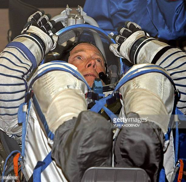 US space tourist Gregory Olsen closes his helmet during testing of the spacesuit prior to the launch of SoyuzTMA7 space vehicle with international...
