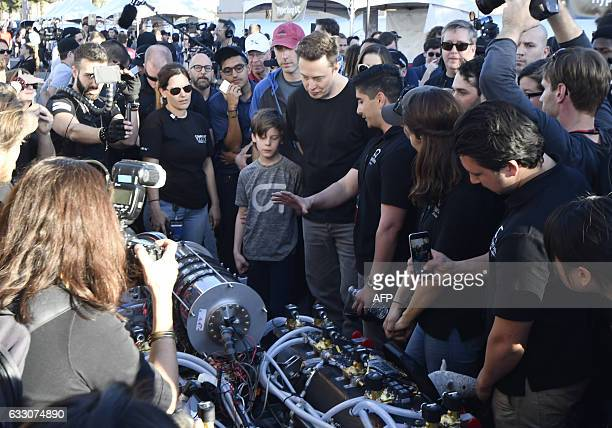 Space X CEO Elon Musk checks out the HYPERXITE University of California Irvine pod during the SpaceX Hyperloop competition in Hawthorne California on...