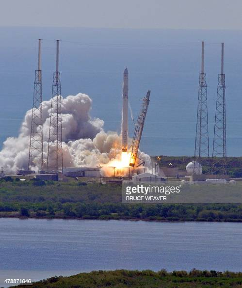 Space X's Falcon 9 rocket as it lifts off from space launch complex 40 at Cape Canaveral Florida June 28 2015 with a Dragon CRS7 spacecraft The...