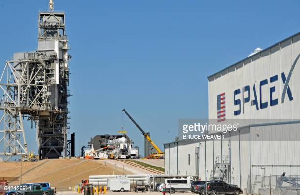 Space X's Falcon 9 rocket is prepared for a launch to the International Space Station February 17 2017 at the Kennedy Space Center Florida on LC39A...