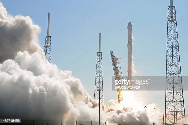 Space X's Falcon 9 rocket lifts off from space launch complex 40 on April 14 2015 at Cape Canaveral Florida with a Dragon CRS6 spacecraft The Dragon...