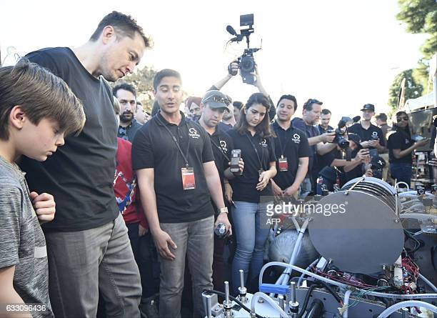 SpaceX CEO Elon Musk checks out the University of California Irvine's HYPERXITE pod during the SpaceX Hyperloop competition in Hawthorne California...